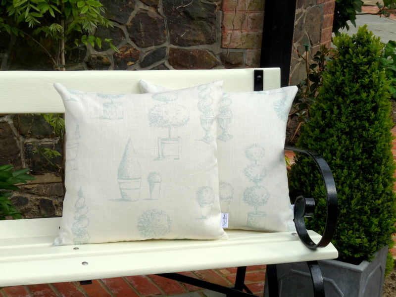 Topiary cushion in aqua