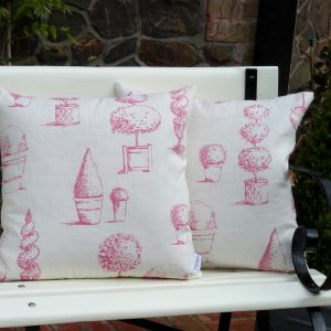 Topiary cushion in raspberry