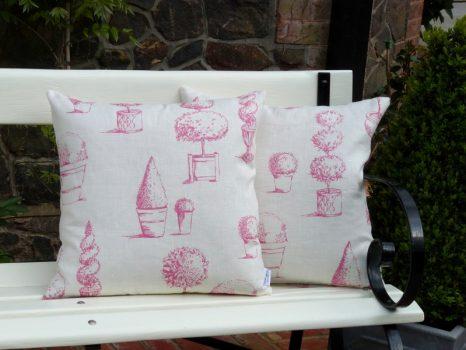 Topiary cushion in raspberry