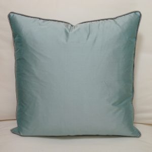 Contrast piped cushion. Aqua with pewter piping.