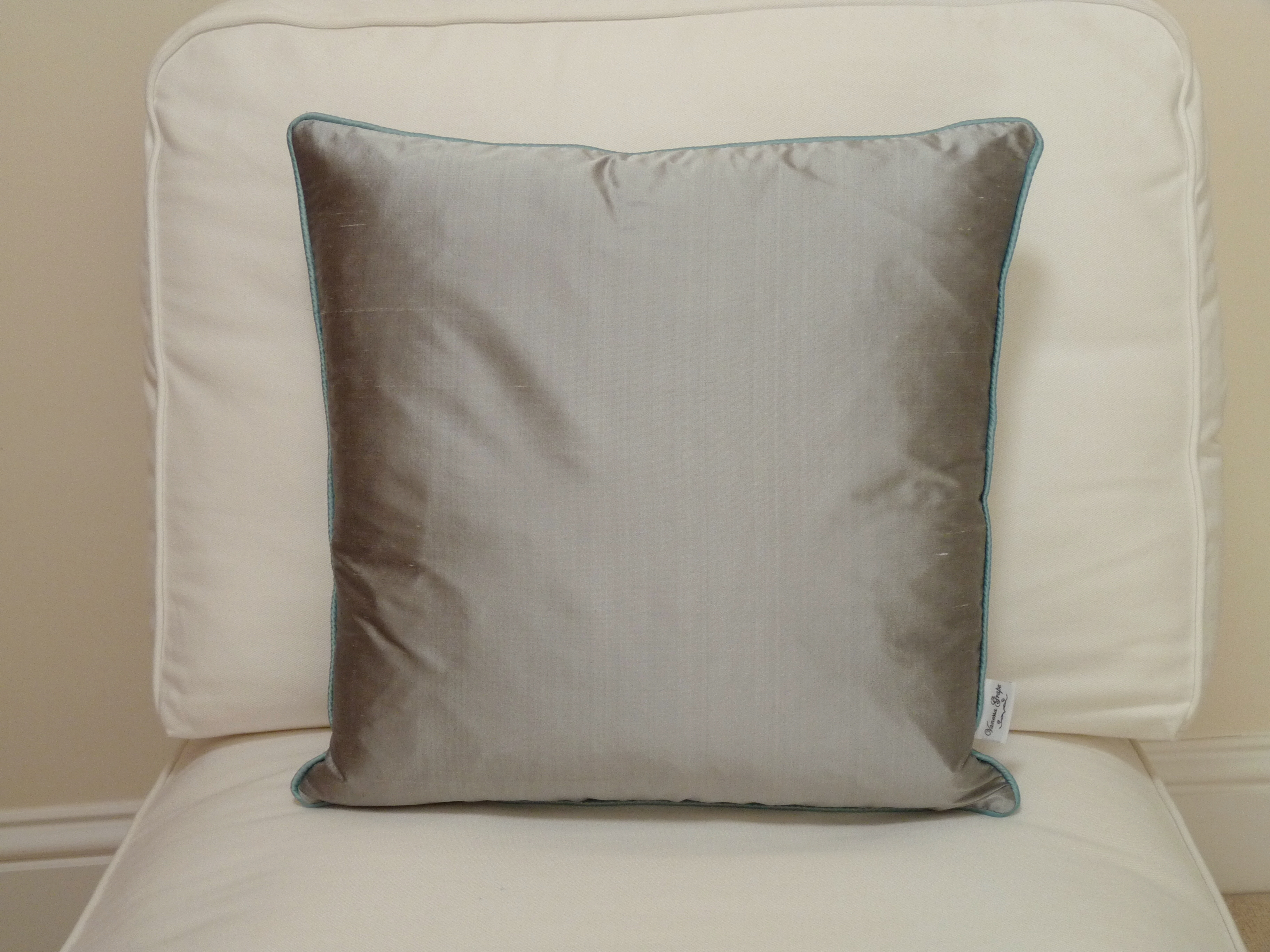 Contrast piped cushion. Pewter with aqua piping.