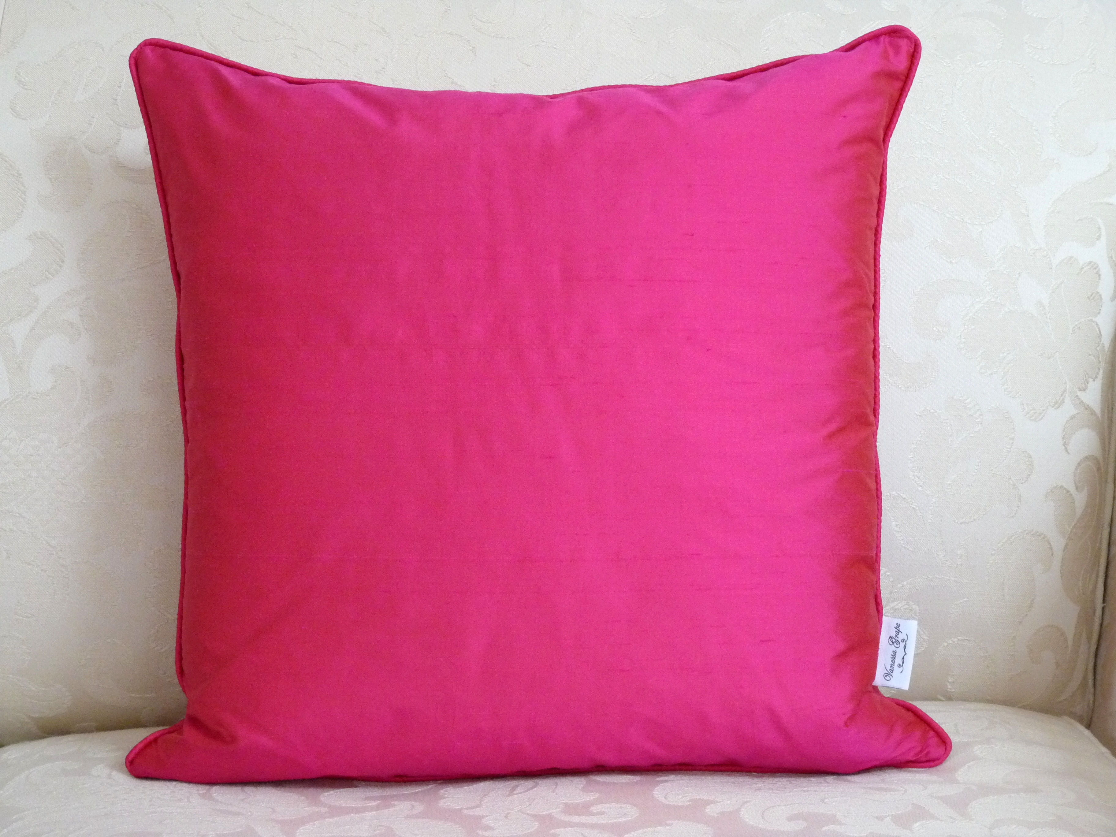 Silk square cushion in cerise