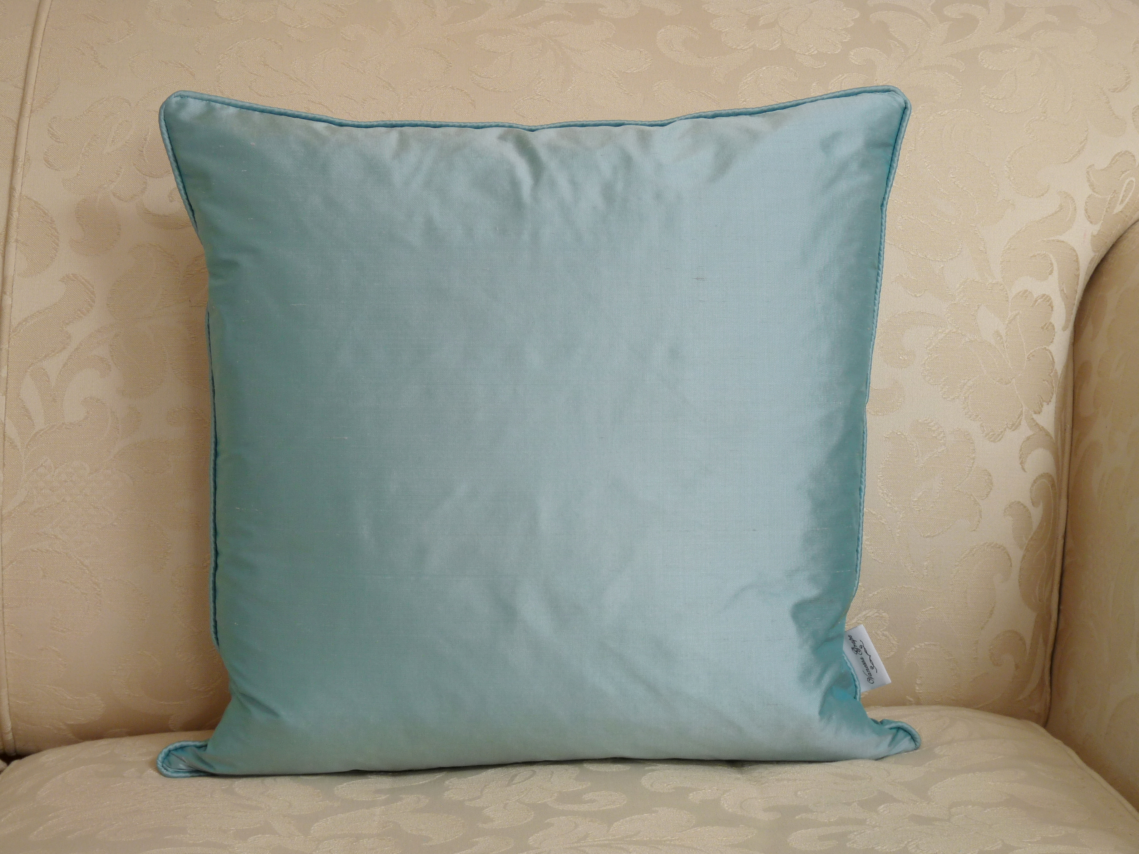 Silk square cushion in aqua
