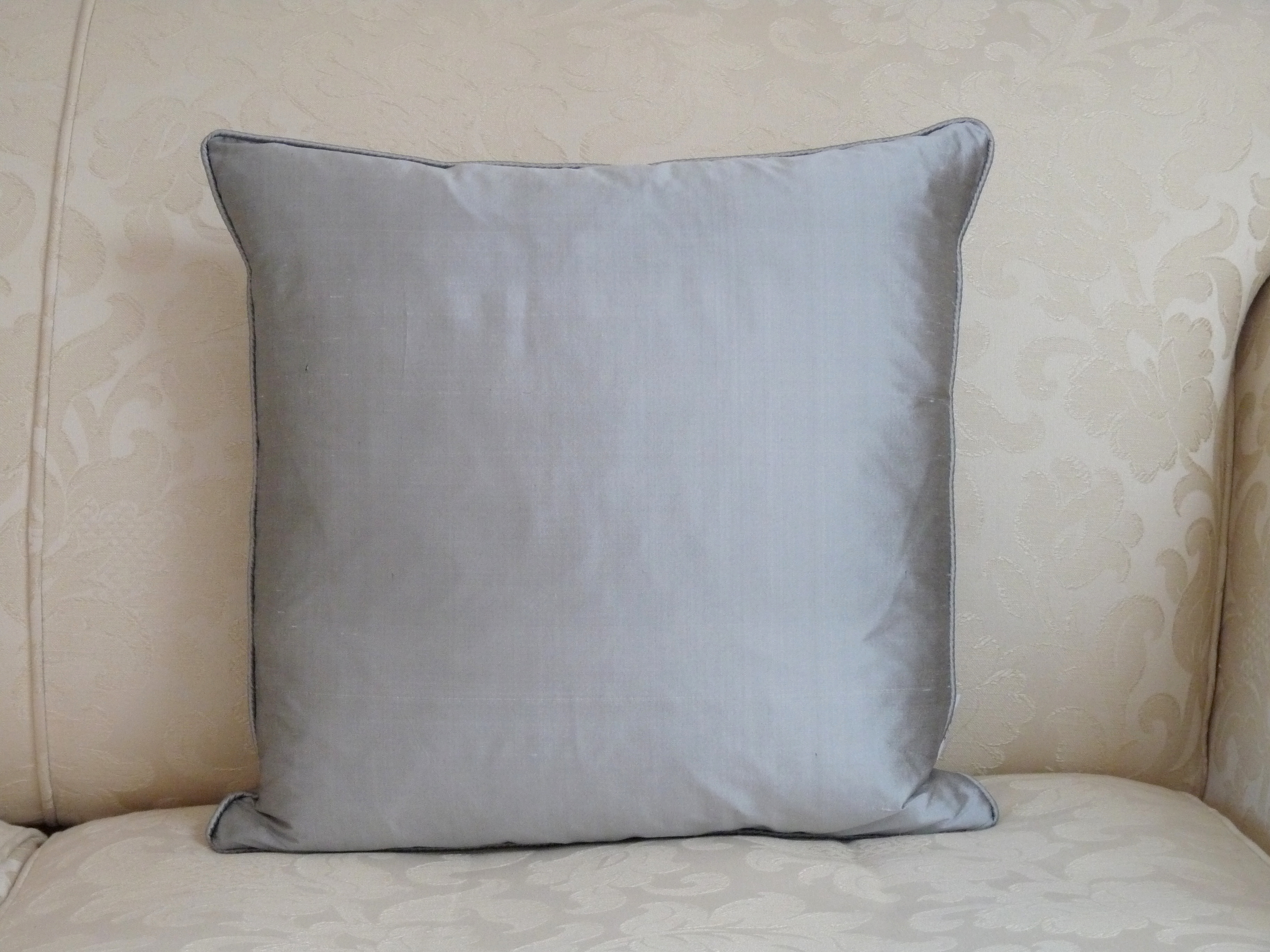 Silk square cushion in pewter